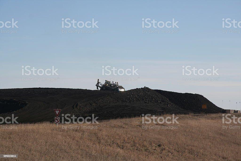 Bull Dozing Coal royalty-free stock photo