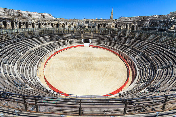 Bull fighting arena in Roman amphitheater in Nimes, France Bull Fighting Arena Nimes (Roman Amphitheater), France amphitheater stock pictures, royalty-free photos & images