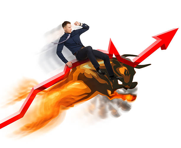 Bull market concept on Stock Exchange Jumping bull carries Stock Exchange broker up on red line of growing trend on white background.  Active sales in bullish market concept. bull market stock pictures, royalty-free photos & images