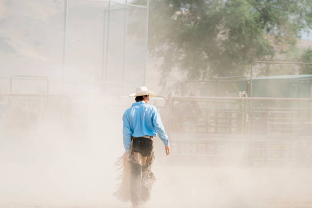 Bull Rider Walks Through The Dust After His Ride stock photo