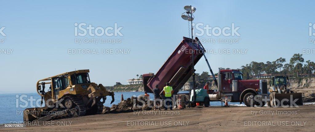 Bulldozer And Dump Truck Unloading Dirt On Goleta Beach California Royalty Free Stock