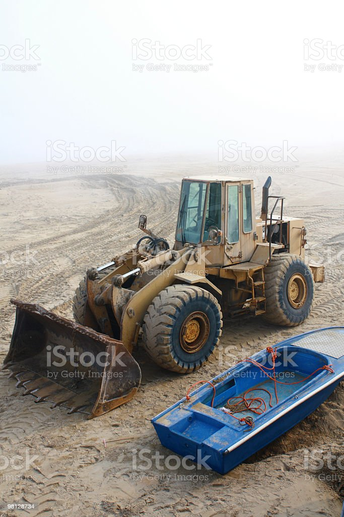 Bulldozer and the boat royalty-free stock photo