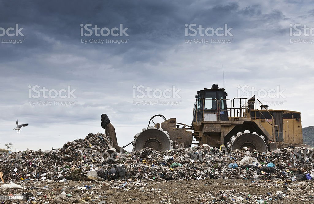 Bulldozer at garbage collection center stock photo