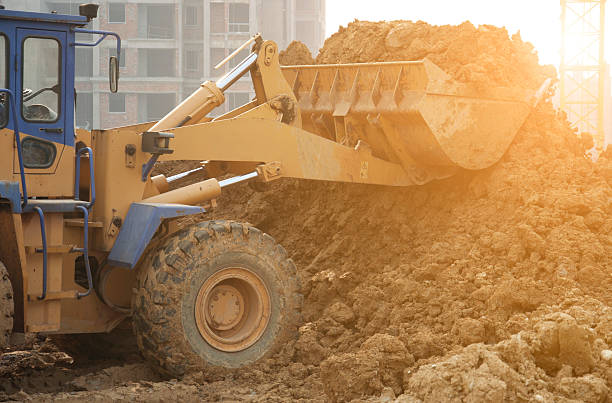 bulldozer at work bulldozer at work archaeology stock pictures, royalty-free photos & images