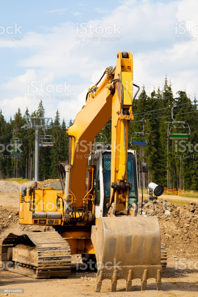 Bulldozer close up tractor at chair alpine lift gondola construction stock photo