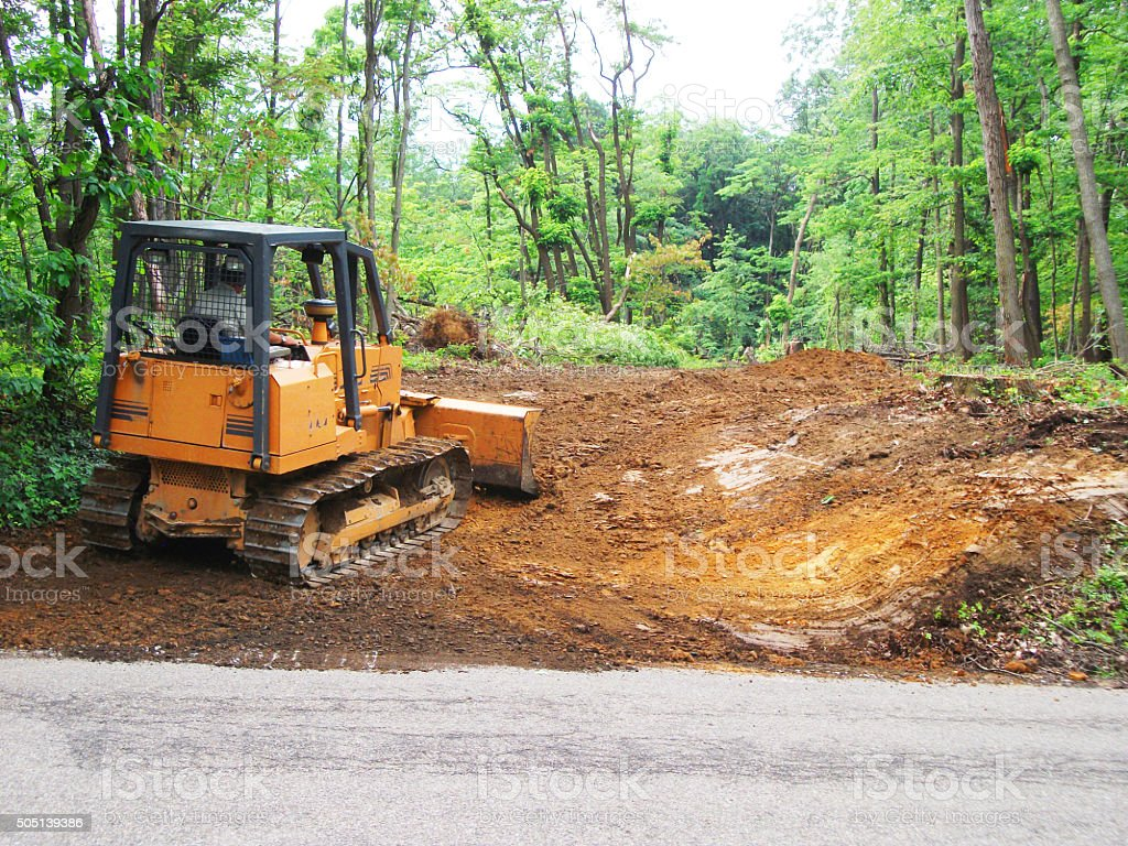 Bulldozer Constructing Excavating Driveway stock photo