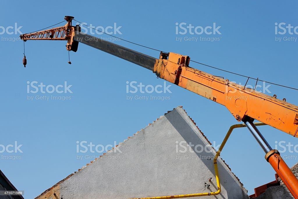 Bulldozer destroying roof royalty-free stock photo