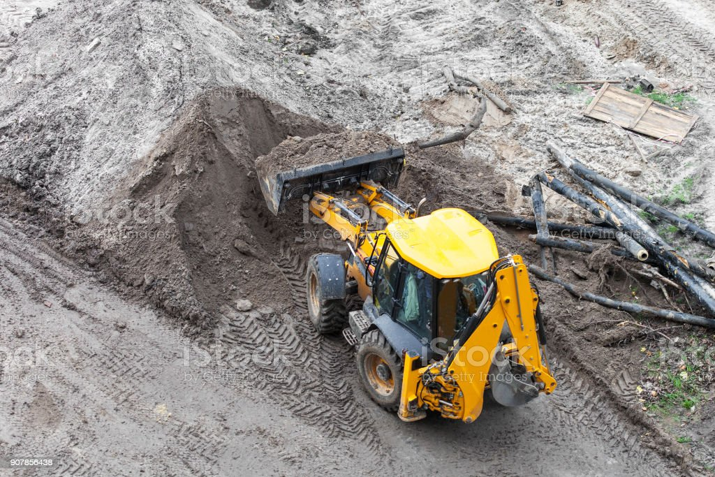 Bulldozer digging the ground stock photo