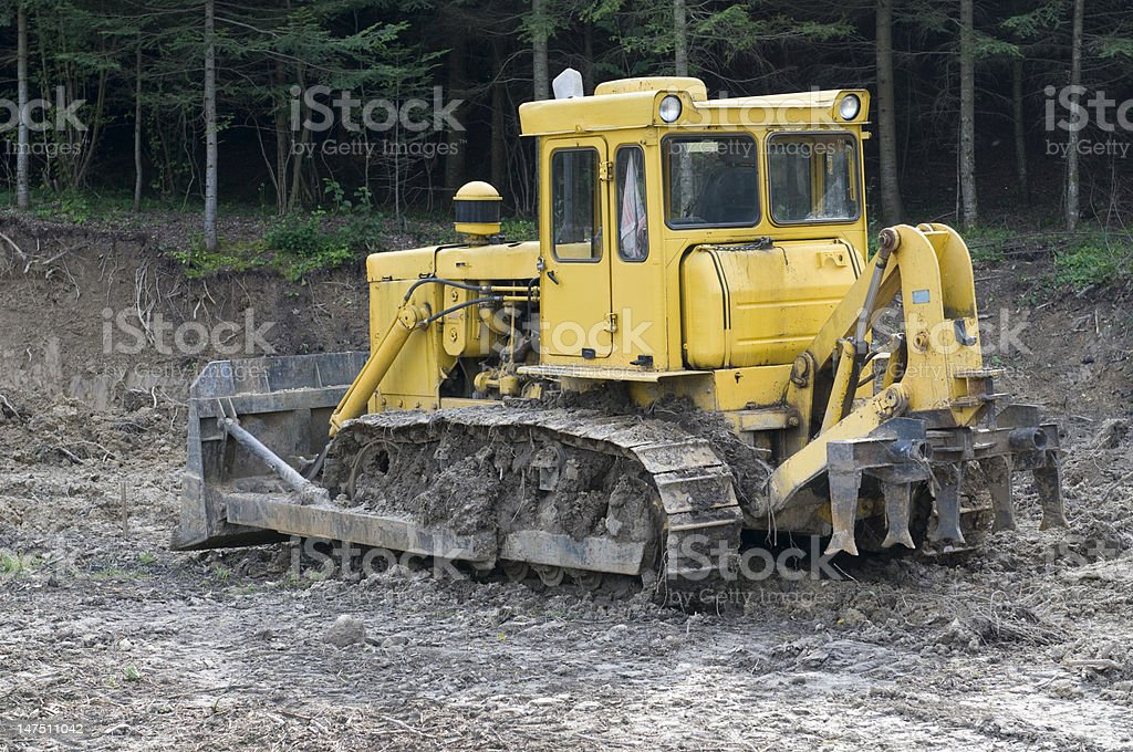 Bulldozer grubbing stock photo