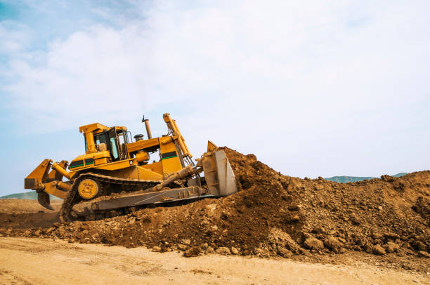 Bulldozer in open field operation stock photo