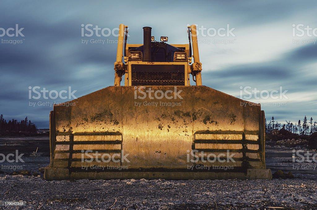 Bulldozer in Twilight stock photo