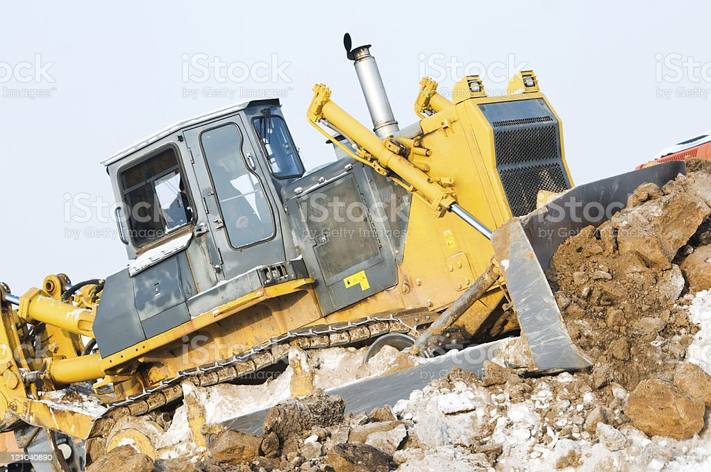 bulldozer loader at winter frozen soil excavation works royalty-free stock photo