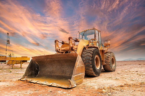 Bulldozer loader machine during earthmoving works Bulldozer loader machine during earthmoving works outdoors construction machinery stock pictures, royalty-free photos & images
