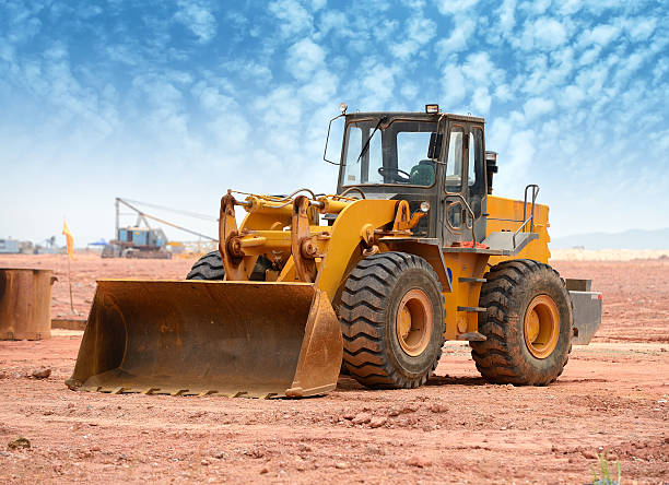 Bulldozer loading machine in the middle of a job stock photo