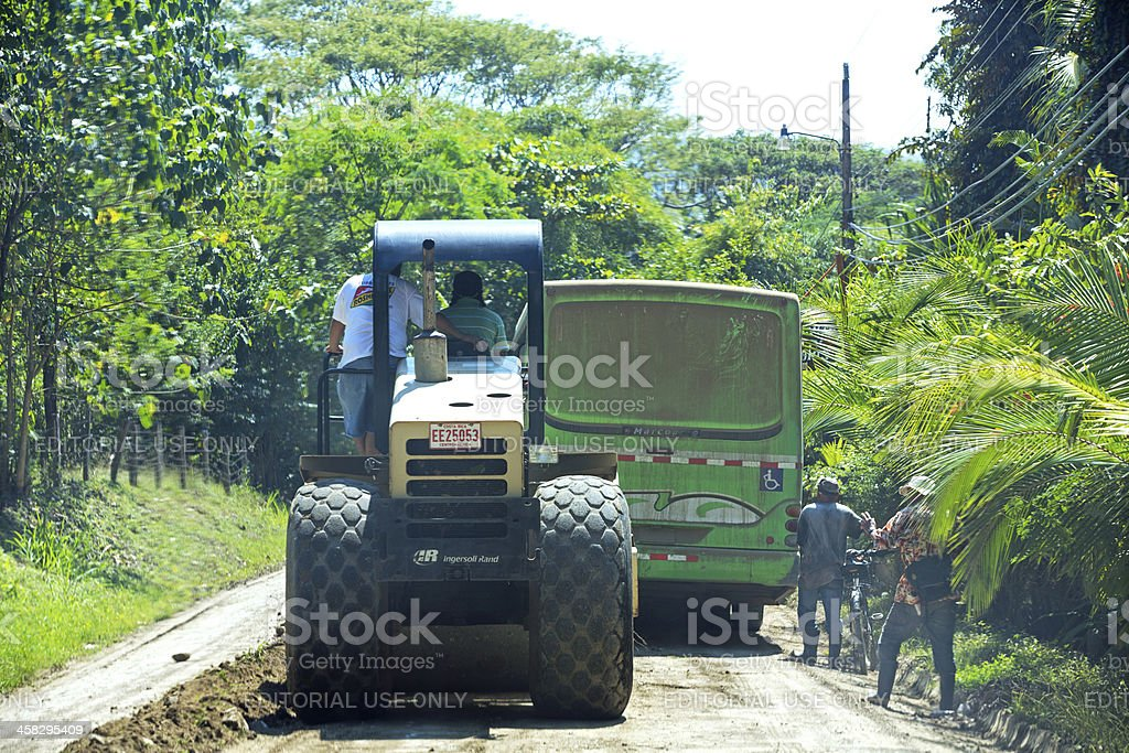 Bulldozer on a dirt road royalty-free stock photo