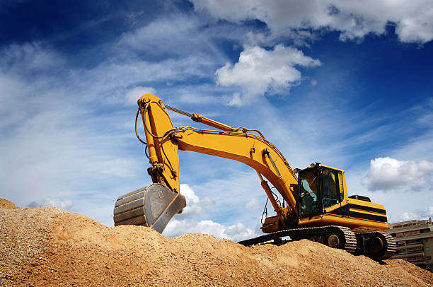 Bulldozer Excavadora realizando movimientos de tierra construction machinery stock pictures, royalty-free photos & images