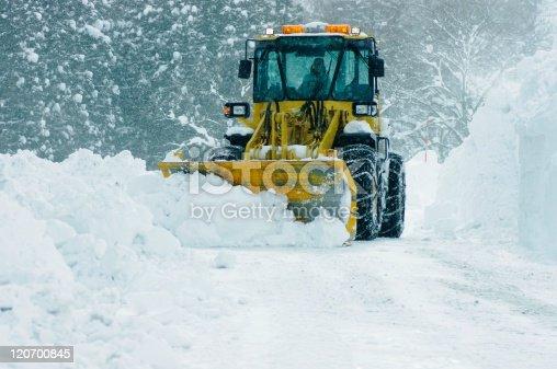 big bulldozer removing snow