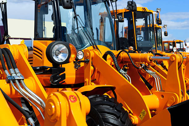 bulldozer row detail - construction equipment stock photos and pictures