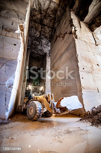 Bulldozer Transporting Rocks Out of Quarry.