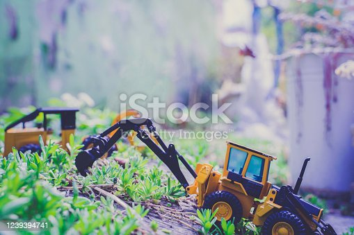 A close-up shot of a slanted bulldozer toy for a dynamic scene.