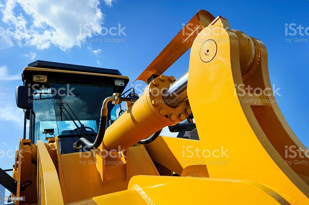 Bulldozer with yellow scoop stock photo