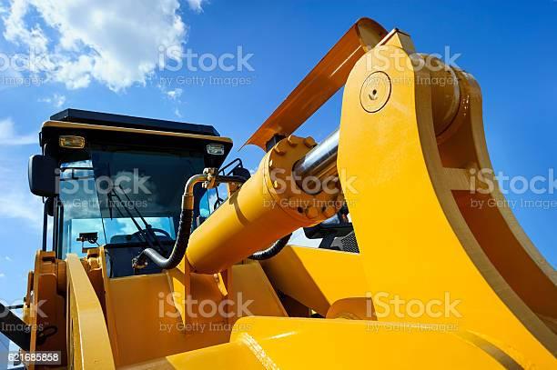 Photo of Bulldozer with yellow scoop