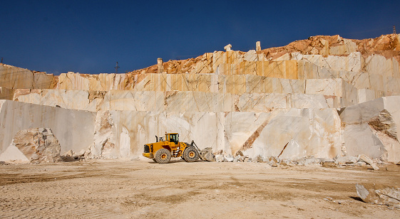Bulldozer working in the marble quarry