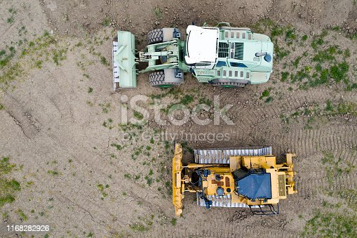 Wheeled front loader and bulldozer, aerial view.
