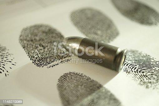 shot of bullet and fingerprint