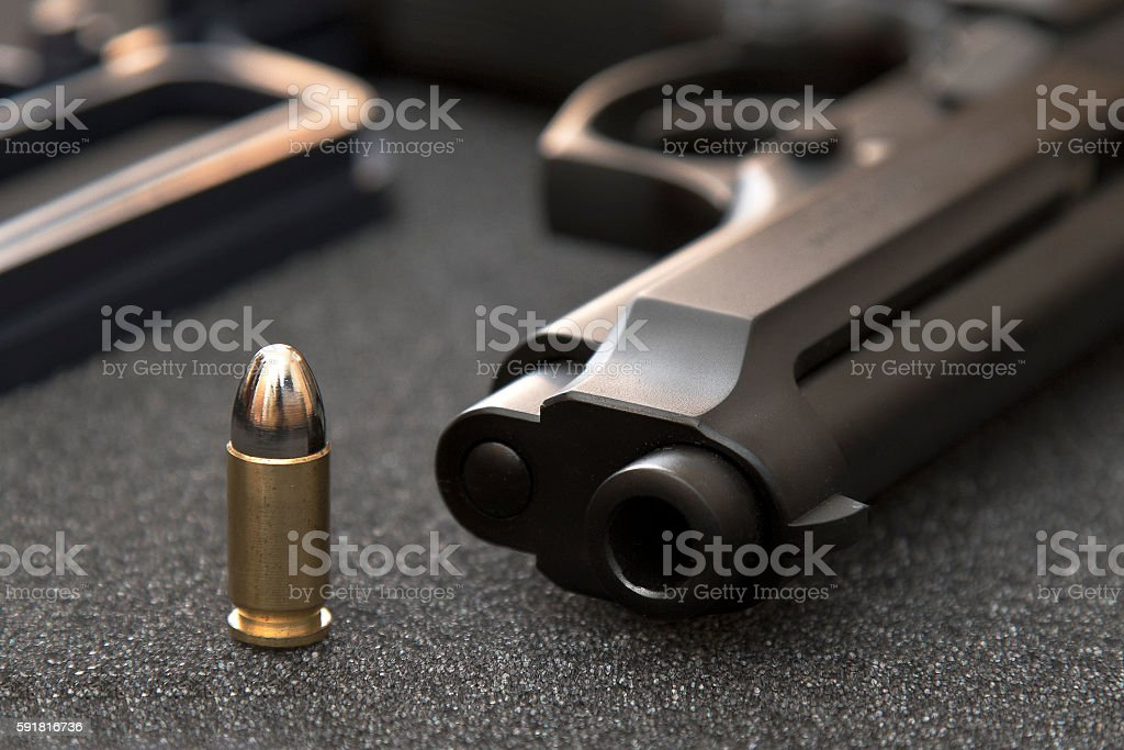 Bullet and gun stock photo