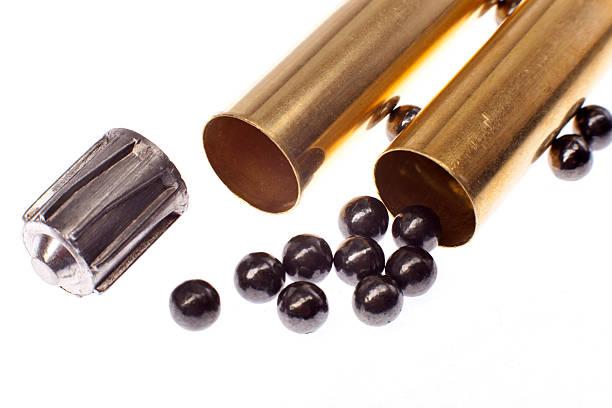 bullet, buckshot and brass shell casings stock photo