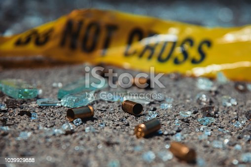 Bullet casings and broken glass. Crime scene.