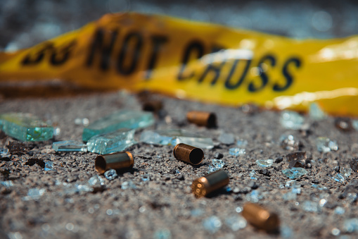 Bullet casings and broken glass. Crime scene.