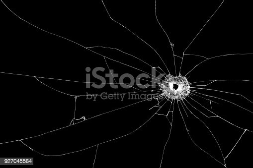 istock Bullet hole broken glass isolated on black background. Cut out. 927045564