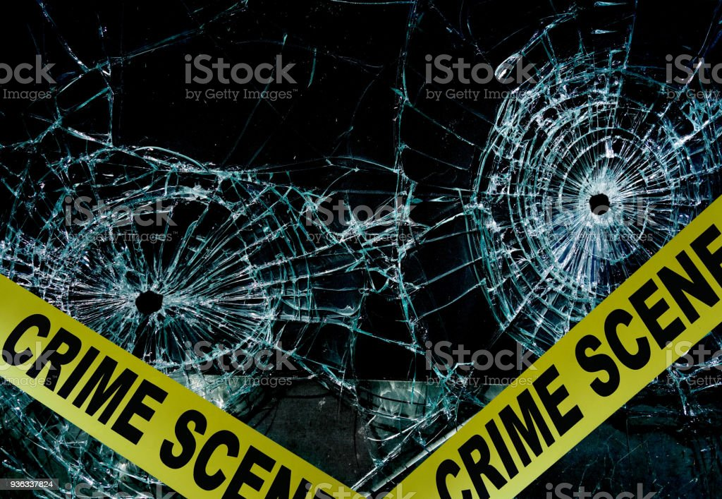 Bullet hole glass stock photo