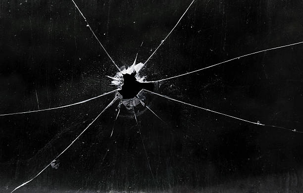 a bullet hole in a glass window - splittrat glas bildbanksfoton och bilder