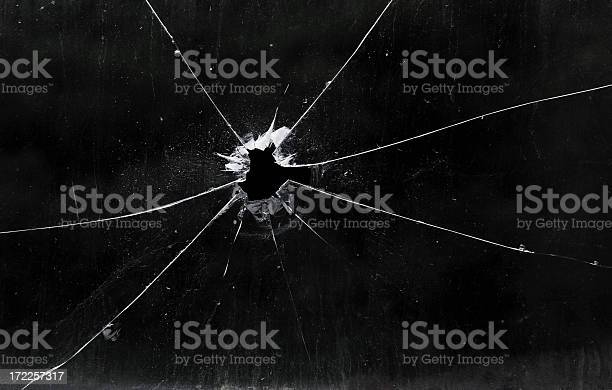 A Bullet Hole In A Glass Window Stock Photo - Download Image Now