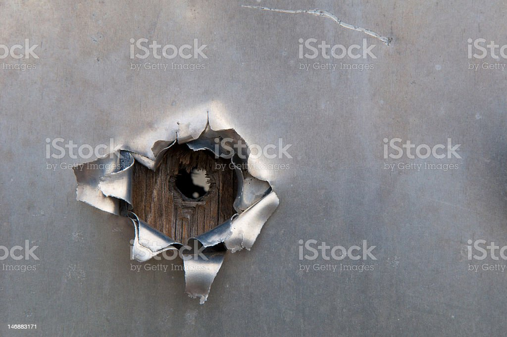 Bullet hole in aluminum stock photo