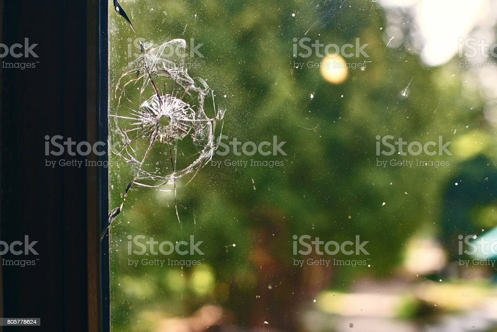Bullet hole in the window stock photo