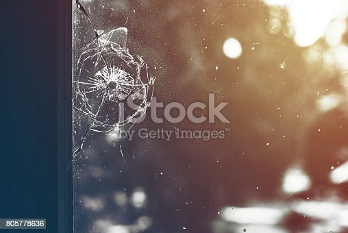 istock Bullet hole in the window toned 805778636
