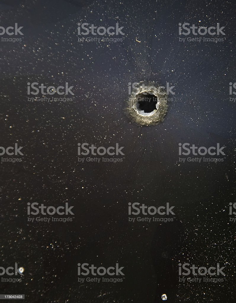 bullet hole on black royalty-free stock photo