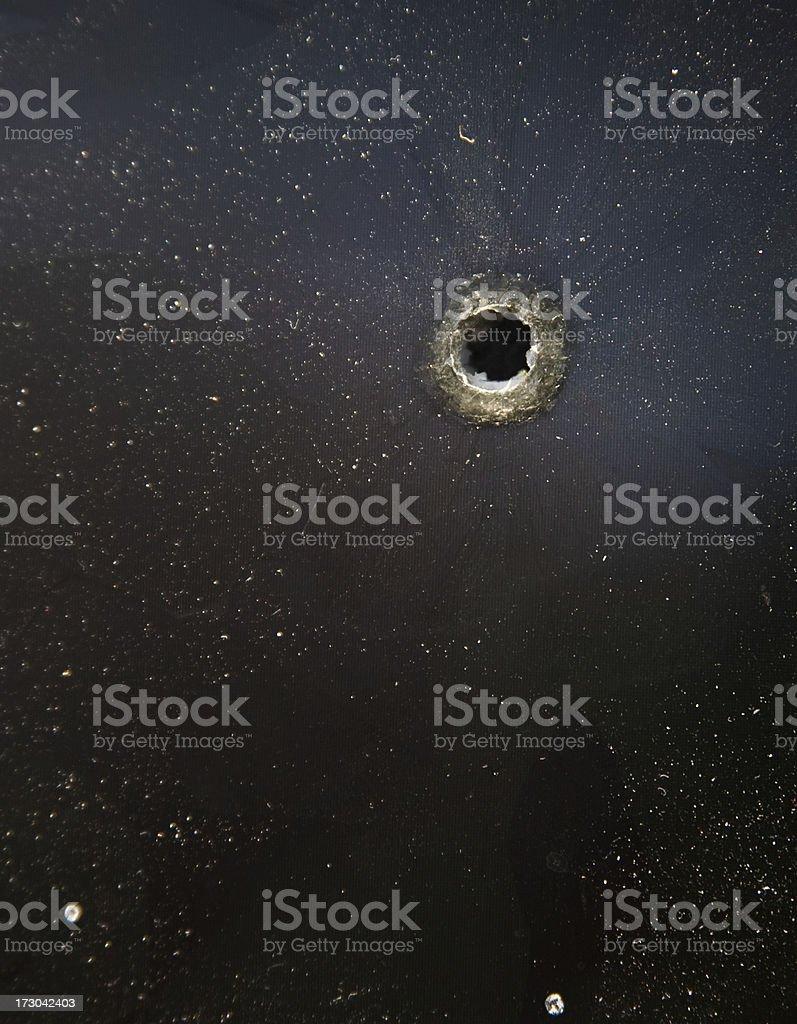 bullet hole on black stock photo