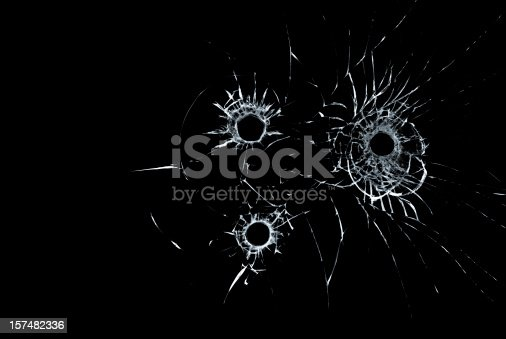 bullet hole in glass on black background