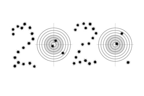 Bullet holes and targets in shape of 2020 stock photo