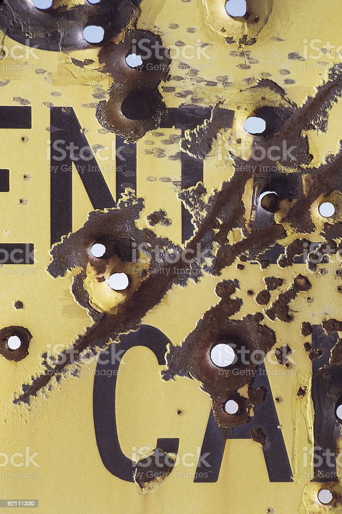 Bullet holes in a highway sign royalty-free stock photo