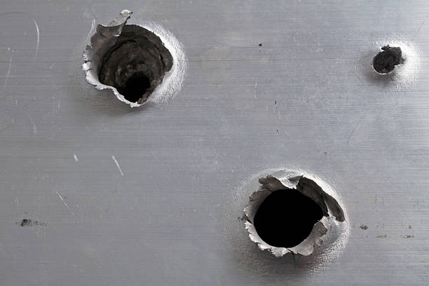 Best Bullet Hole Metal Stock Photos Pictures Royalty Free