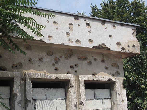 Bullet holes in an old building in Mostar, Bosnia and Herzegovina stock photo