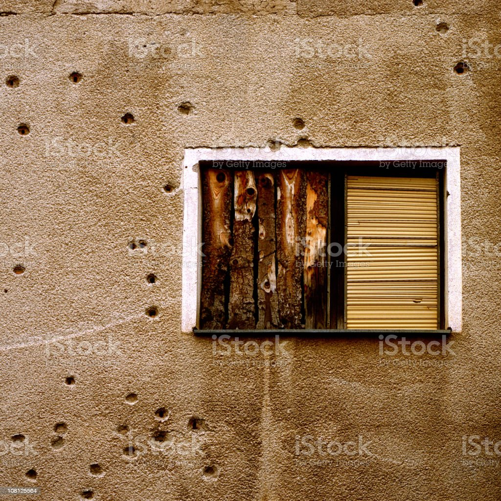 Bullet Holes in Exterior Wall royalty-free stock photo