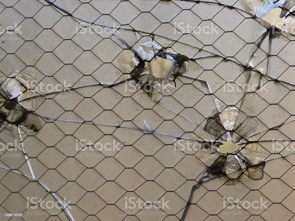 Bullet holes in glass stock photo