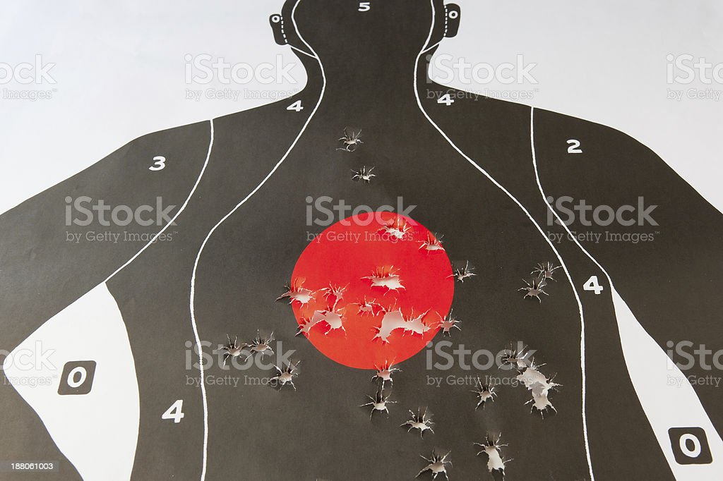 bullet holes in the target stock photo